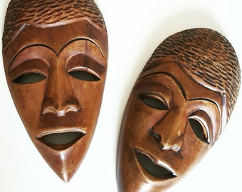 Vintage pair of hand carved wooden face masks from Haiti