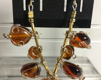 Amber glass beaded drop down earrings with gold findings