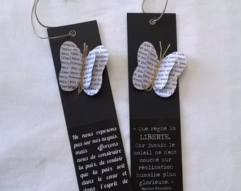 Freedom, peace: two long, black labels with citations and butterflies