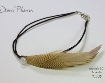 Bracelet (wrist) with feathers