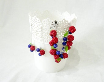 Jewelry set with raspberries and blueberries.
