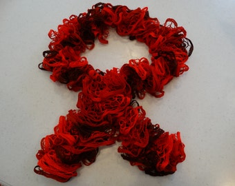 red and black curly scarf