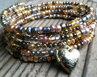 Copper and gold bracelet with heart locket