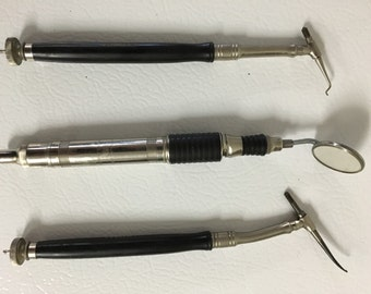 Vintage dental picks and mirror