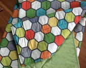 Whole cloth baby blanket and play mat, colorful hexagonal design