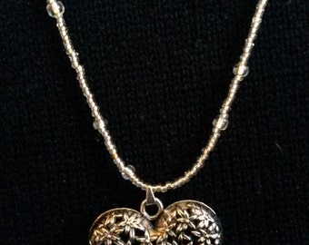 Long silver puffed heart pendant necklace