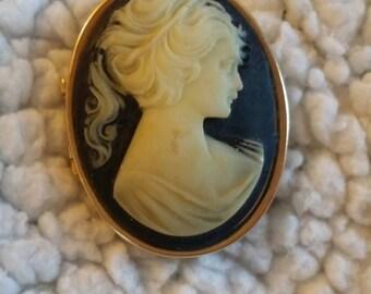 Large gold navy blue cameo locket