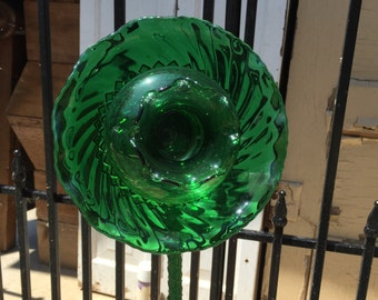 Green glass recycled glassware garden art