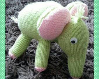 Hand knitted elephant stuffed toy