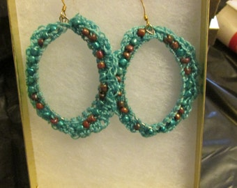 Handmade Crocheted Teal colored hoop earrings!