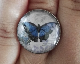 ring variable at will with an blue vintage butterfly cabochon 18mm