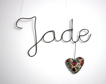 First name in wire with a heart