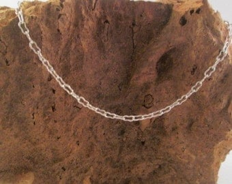 Silver chain with 'peanut' shaped links. Hallmarked