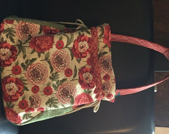 Flowered shades of reds, cream and greens purse