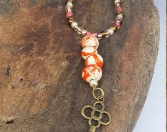 Beige and Orange Swirl with Key