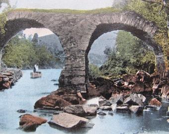 Shooting the Rapids Killarney postcard / posted / Valentine's postcard / old stone bridge postcard