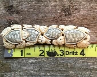 Turtle family pendant