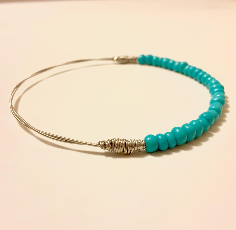 guitar string bead bracelet guitar string bracelet turquoise. Black Bedroom Furniture Sets. Home Design Ideas