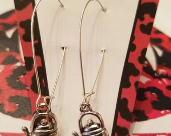 Putting on the kettle earrings