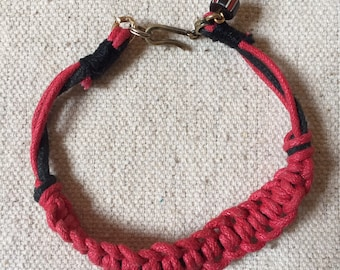 Red & Black crochet braided bracelet with luxury hardware and ancient bead detail.