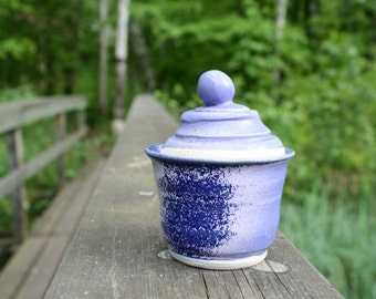 Purple ceramic jar with lid