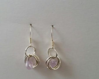 Light pink stones in wire circles