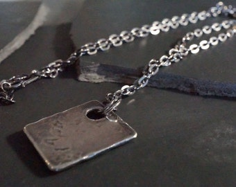 Thick rectangular silver plate solid forged, hammered and aged by hand. Mixed, rustic and trendy - N 3039