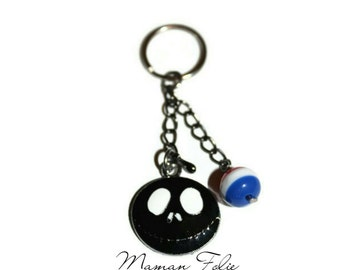Small decorative ring for closing illuminates, keychains or others. Black skeleton