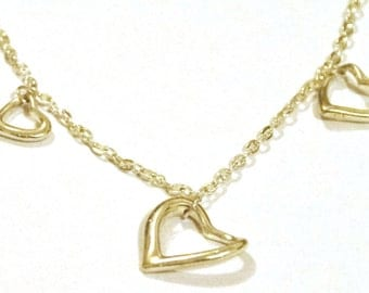 Gorgeous silver bracelet with three heart charms