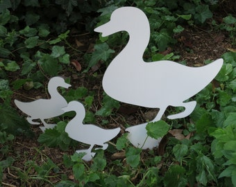 Garden decoration with duck and two ducklings
