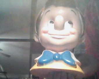 1930 pinocchio bank. valued and appraised at 190.00