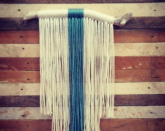 Tiered blue and white yarn tapestry