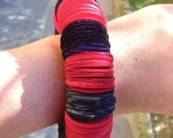 Handmade red and black elastic bracelet with black circles of red construction paper and cardboard, handmade jewelry