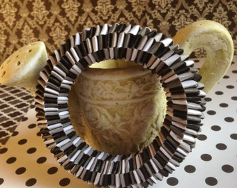 Optical print bracelet made by weaving strips of white construction paper, black and gray, handcrafted jewelry, gift for her