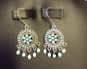 Silver tone with turquoise colored beads  on wires.