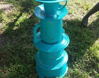 Repurposed pottery bird feeder