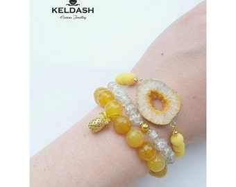 Set of natural stones bracelets with gilded agate druse