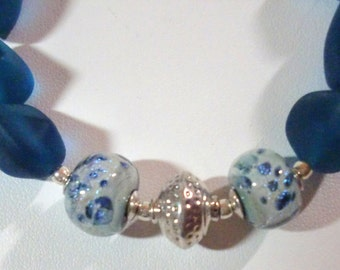 Bracelet: Dimpled Sterling Bicone Focal Bead, Aqua/Teal-Spotted Lampwork Glass Beads, Teal Recycled Glass Nuggets, & SS Filigree Clasp