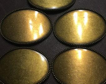 Gold colored belt buckles