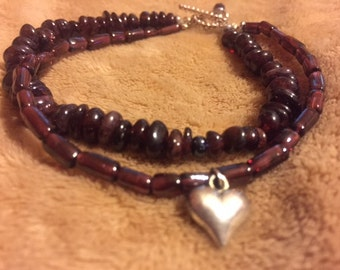 Double Garnett bracelet with a silver heart charm and clasp