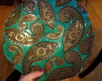 Green and gold decorative plate