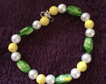 Green, yellow and white beaded bracelet