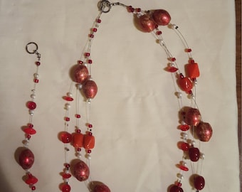 Multi strand red and rust colored set