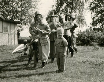 Vintage Snapshot Photograph Halloween or Carnival Creepy Men in Masks with Child and Spear 1950s