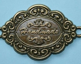 Embellishment Metal Label with Handmade enscribed in the centre