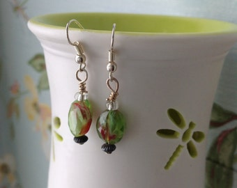 Green and red toned glass bead dangle earrings