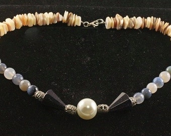Art Deco Shells, Quartz, Glass, and a Faux Pearl in the Center of this Necklace