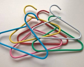 Mini doll hangers! One set 6 pieces.