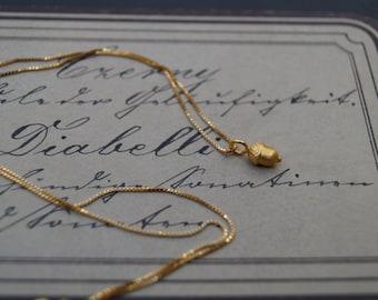 tiny little golden acorn necklace