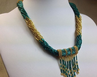 Multistrands Hand Beaded Glass seed Nepal Necklace with Beaded Pendant. Teal and Gold.